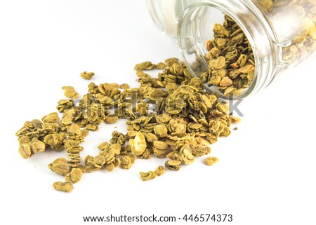 Healthy breakfast. Fresh granola, muesli in a glass jar. Organic oat,almond and sunflower seeds isolated - stock photo