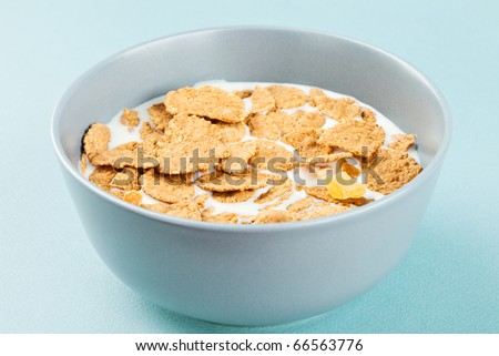 Healthy breakfast - milk with corn flakes - stock photo
