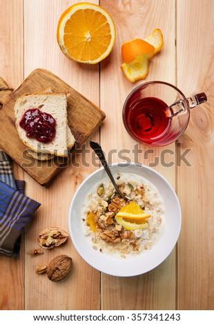 healthy breakfast, oatmeal porridge on rustic background - stock photo