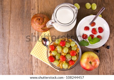 Healthy breakfast on wooden table, upper view - stock photo