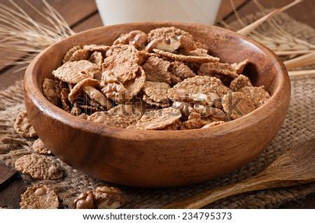 Healthy breakfast - whole grain muesli with a walnut in a wooden bowl - stock photo