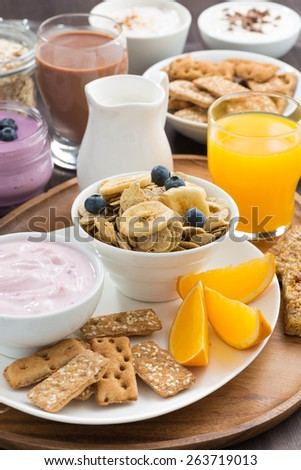 Healthy breakfast with cereal, vertical, close-up - stock photo
