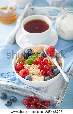 healthy breakfast with cornflakes and berry - stock photo