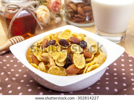Healthy breakfast with cornflakes, yougurt and fresh berries on dark wooden table, selective focus - stock photo