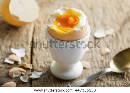 Healthy breakfast with perfect soft boiled egg. Delicious homemade food. - stock photo