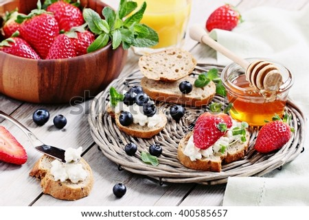 Healthy breakfast with wholegrain bread,cottage cheese and fresh berries.Selective focus - stock photo