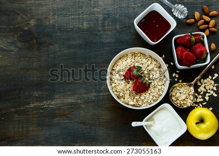 Healthy Breakfast. Yogurt with muesli and berries on rustic wooden background. Health and diet concept. Top view. - stock photo