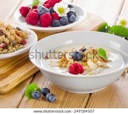 Healthy breakfast - yogurt with muesli . Selective focus - stock photo