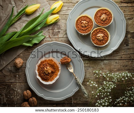 Healthy carrot muffins with walnut half on top - stock photo