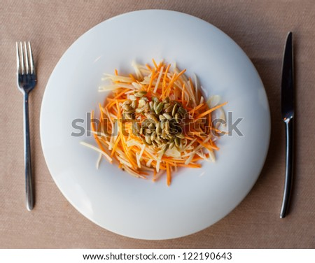 healthy carrot salad from above with shallow DOF - stock photo