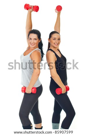 Healthy cheerful women working with dumbbell isolated on white background - stock photo