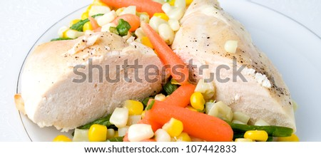 Healthy chicken and vegetables with corn and carrots - stock photo