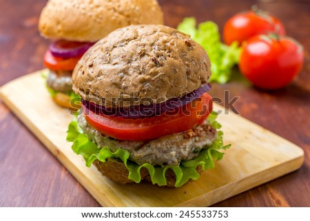 Healthy Chicken Hamburger with a Whole Grain Bun and Vegetables - stock photo