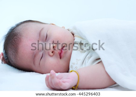 Healthy children concept. Closeup portrait of sleeping baby. Adorable asian girl sleeping peacefully on bed. - stock photo