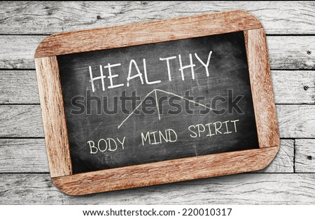 Healthy concept. Body, Mind, and Spirit drawing on blackboard  - stock photo