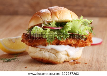 healthy crispy fish burger - stock photo