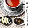 Healthy cup of tea arrangement with honey, lemon and herbals - stock photo