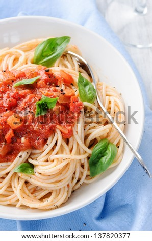 Healthy delicious vegetarian pasta dish with tomato sauce and basil leaves, traditional italian meal and mediterranean cuisine - stock photo