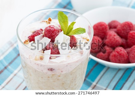 healthy dessert with oatmeal, whipped cream and raspberries, close-up, horizontal - stock photo