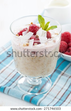 healthy dessert with oatmeal, whipped cream and raspberries, vertical, close-up, top view - stock photo