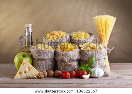 Healthy diet food with pasta and fresh ingredients - stock photo