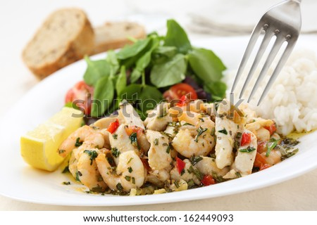 healthy dish of fried chicken and shrimps with watercress and white rice  - stock photo