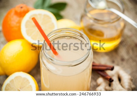 Healthy drink with lemon, cinnamon, ginger and honey to prevent cold - stock photo
