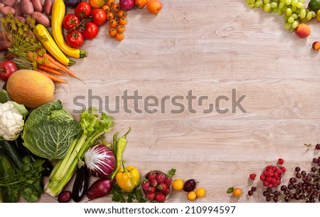 Healthy eating background / studio photography of different fruits and vegetables on wooden table  - stock photo