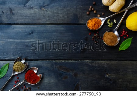 Healthy eating Background with herbs and spices selection on dark wooden table. Food or cooking concept, top view. - stock photo