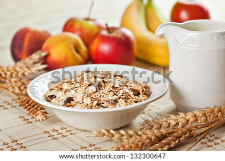 Healthy eating breakfast low calories bowl of swiss muesli with fruits and milk - stock photo