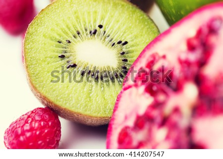 healthy eating, food and diet concept- close up of ripe kiwi and other fruits - stock photo