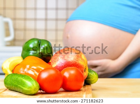 Healthy eating for pregnant woman - stock photo