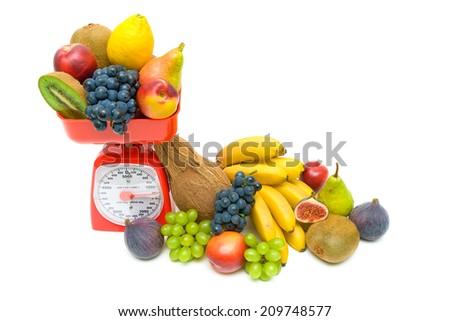 Healthy Eating: Fresh fruits and kitchen scale on white background. horizontal photo. - stock photo