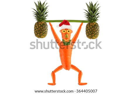 Healthy eating. Funny little man  raises bar.  Happy New Year. - stock photo