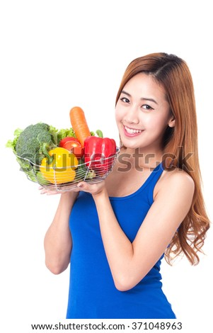 Healthy eating, happy young woman with vegetables on white background - stock photo