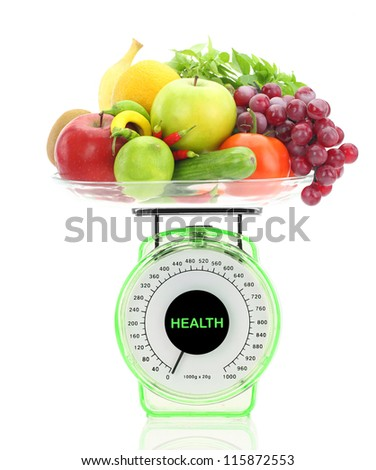 Healthy eating. Kitchen scale with fruits and vegetables - stock photo
