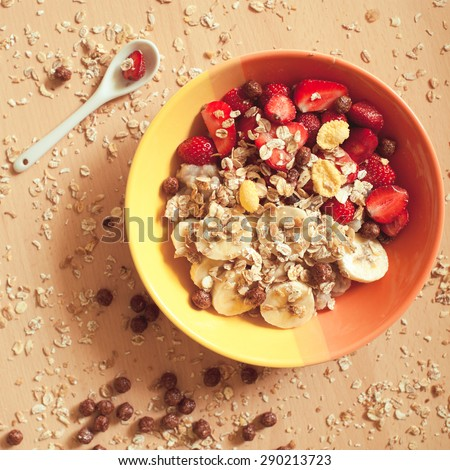 Healthy eating. Vegan diet. Granola with oatmeal, bananas, strawberry close up. Top view.  - stock photo