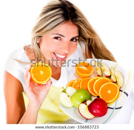 Healthy eating woman holding a tray of fruits - isolated over white - stock photo