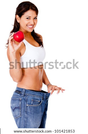 Healthy eating woman in loose pants - isolated over a white background - stock photo
