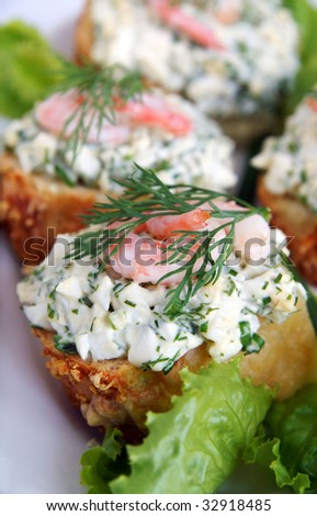 Healthy enrich sandwiches with shrimps, boiled eggs, green vegetables and herbs, blur background, vertical, closeup - stock photo