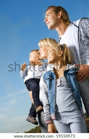 Healthy Family Outdoor.Happy Mother and Father with Kids over blue sky - stock photo