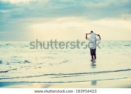 Healthy Father and Daughter Playing Together at the Beach at Sunset. Happy Fun Lifestyle - stock photo