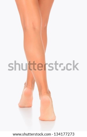 Healthy female legs on a white background - stock photo