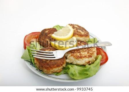 Healthy fish cakes dish - stock photo