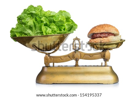 Healthy food and unhealthy food on scales.Dieting concept.Isolated. - stock photo