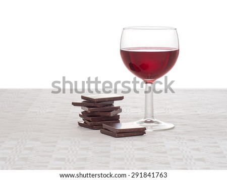 Healthy food, apparently. Red wine and dark chocolate, good for the heart. - stock photo