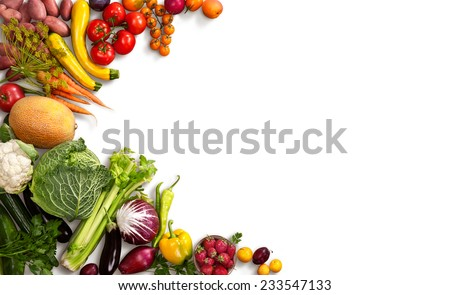 Healthy food background / studio photo of different fruits and vegetables on white backdrop  - stock photo