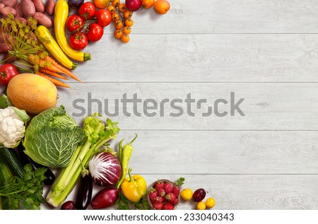 Healthy food background / studio photo of different fruits and vegetables on wooden table  - stock photo