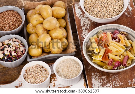 Healthy Food: Best Sources of Carbs on a wooden table. Top view - stock photo