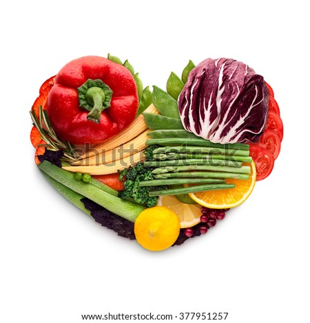 Healthy food concept of a human heart made of vegetable mix that reduce death risk, isolated on white. - stock photo